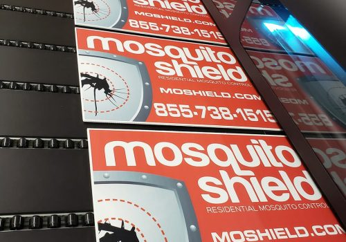 Mosquito Shield yard signs